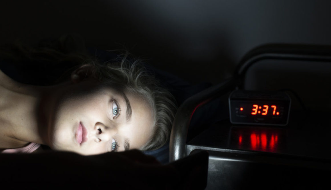Girl using her smartphone late at night
