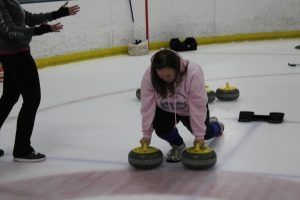 Getting the hang of curling in Oakland.