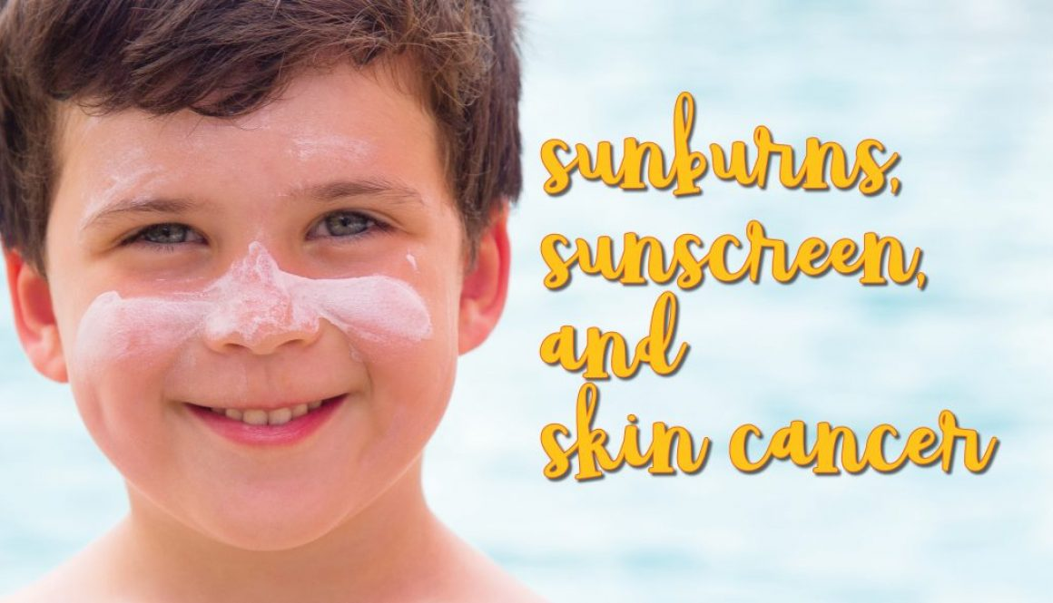 Smiling boy with sunscreen on his face