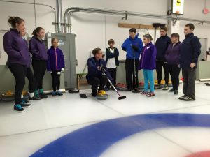 Olympian Viktor Kjäll explains the art of sliding to young curlers.