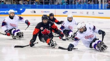 Canadian sled hockey player on ice.