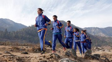 Men and Women wearing tracksuits and jogging in Nepal