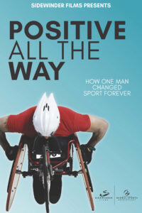 Film Poster with Positive All the Way title and man in racing wheelchair