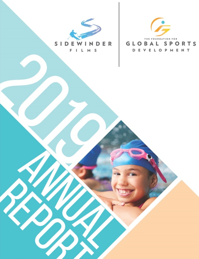 2019 annual report cover showing young girl smiling in a swimming cap and goggles